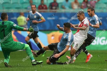 Uruguay's goalkeeper Fernando Muslera, left, and Uruguay's Jose Gimenez, second left, block a shot by Peru's Paolo Guerrero, 9, during a Copa America quarterfinal soccer match at the Arena Fonte Nova in Salvador, Brazil