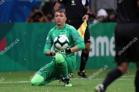 Uruguay's goalkeeper Fernando Muslera reacts after loosing the penalty shoot-out against Peru during a Copa America quarterfinal soccer match at the Arena Fonte Nova in Salvador, Brazil