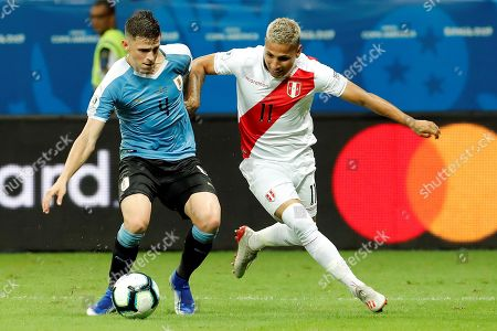 Uruguay's Giovanni Gonzalez (L) in action against Peruvian Raul Ruidiaz (R) during the Copa America 2019 quarter-finals soccer match between Uruguay and Peru, at Arena Fonte Nova Stadium in Salvador, Brazil, 29 June 2019.