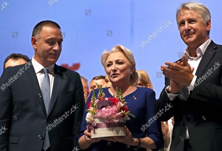 Romanian Prime Minister Viorica Dancila (C) is applauded by her colleagues Mihai Fifor, the new party secretary general (L), and Eugen Teodorovici (R), finance minister and the new party executive president, at the Social Democracy Party (PSD) Extraordinary Congress, after she was elected the party leader, in Bucharest, Romania, 29 June 2019.  Dancila obtained 2,828 votes out of a total of 3,961 party members present at the congress, and became the female party leader.