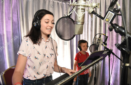 Stock Picture of Jessica McKenna, left, and Ronan Moffett practice voice over technique during It's Not Just a Cartoon 2019: A Celebration of Diversity in Animation at the Television Academy, in Los Angeles