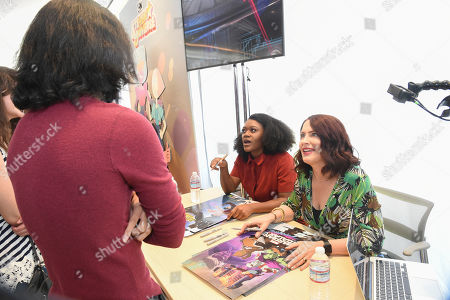 Stock Picture of Voice over artists Daisy Lightfoot, left, and Vanessa Marshall sign posters during It's Not Just a Cartoon 2019: A Celebration of Diversity in Animation at the Television Academy, in Los Angeles