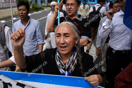 Stock Picture of Rebiya Kadeer, a political activist for China Uyghur ethnic minority, leads a demonstration against the Chinese government's treatment of the ethnic group at a demonstration during the G20 Summit