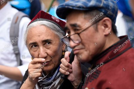 Rebiya Kadeer, a political activist for China Uyghur ethnic minority, speaks to another activist during a demonstration against the Chinese government's treatment of the ethnic group at a demonstration during the G20 Summit