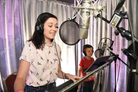 Stock Photo of Jessica McKenna and Ronan Moffett practice voice over during It's Not Just a Cartoon 2019: A Celebration of Diversity in Animation at the Television Academy, in Los Angeles