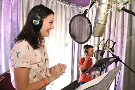 Stock Image of Jessica McKenna and Ronan Moffett practice voice over during It's Not Just a Cartoon 2019: A Celebration of Diversity in Animation at the Television Academy, in Los Angeles