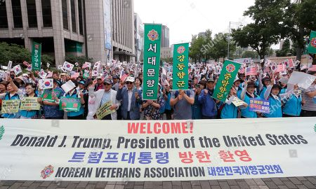 """Members of the Korean Veterans Association stage a rally to welcome a visit by U.S. President Donald Trump in Seoul, South Korea, . North Korea said Saturday Trump's offer to meet leader Kim Jong Un at the Demilitarized Zone is a """"very interesting suggestion,"""" brightening prospects for a third face-to-face meeting between the two leaders"""