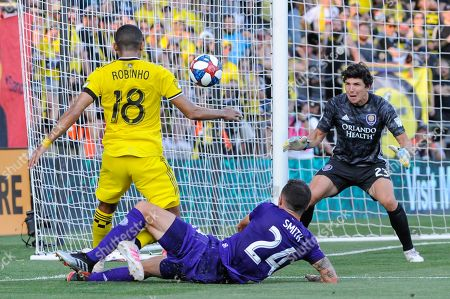 Columbus Crew SC forward Robinho (18) takes a shot while Orlando City defender Kyle Smith (24) attempt to block the first half of the match between Orlando City and Columbus Crew SC at MAPFRE Stadium, in Columbus OH. Mandatory Photo Credit: Dorn Byg/Cal Sport Media. ..Orlando City 1 - Columbus Crew SC 0 after the first half