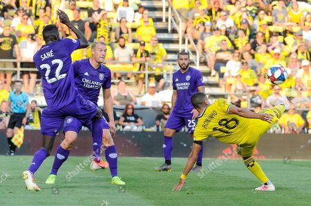 Columbus Crew SC forward Robinho (18) attempts a bicycle kick while Orlando City defender Lamine Sane (22) protects his face the first half of the match between Orlando City and Columbus Crew SC at MAPFRE Stadium, in Columbus OH. Mandatory Photo Credit: Dorn Byg/Cal Sport Media. ..Orlando City 1 - Columbus Crew SC 0 after the first half