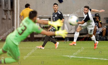 Mexico forward Uriel Antuna (22) watches as his shot on goal is caught by Costa Rica goalkeeper Leonel Moreira (23) as defender Bryan Oviedo (8) also watches during the first half of a CONCACAF Gold Cup soccer quarterfinal, in Houston