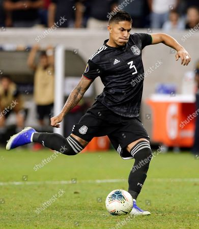 Mexico defender Carlos Salcedo makes the winning penalty kick against Costa Rica during the shootout after the CONCACAF Gold Cup soccer quarterfinal was tied 1-1, in Houston