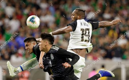 Costa Rica defender Kendall Waston (19) goes over Mexico defenders Carlos Salcedo, left, and Edson Alvarez (4) for a header during the second half of a CONCACAF Gold Cup quarterfinal soccer match, in Houston