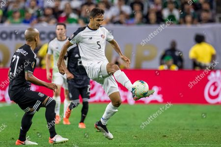 Stock Image of Costa Rica midfielder Celso Borges (5) controls the ball during the 1st half of a CONCACAF Gold Cup quarterfinals soccer match between Costa Rica and Mexico at NRG Stadium in Houston, TX. Mexico won on penalty kicks 1-1 (5-4)
