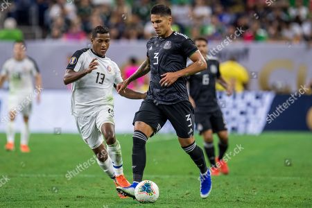 Mexico defender Carlos Salcedo (3) controls the ball in front of Costa Rica midfielder Allan Cruz (13) during the 1st half of a CONCACAF Gold Cup quarterfinals soccer match between Costa Rica and Mexico at NRG Stadium in Houston, TX