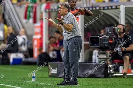 Mexico head coach Gerardo Martino gestures during the 1st half of a CONCACAF Gold Cup quarterfinals soccer match between Costa Rica and Mexico at NRG Stadium in Houston, TX