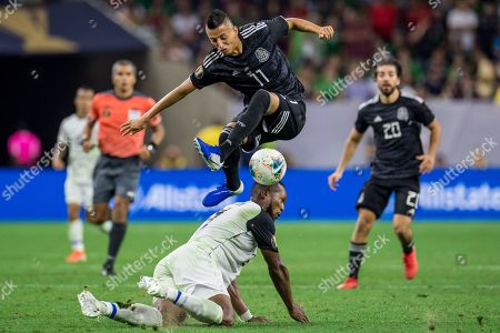 Stock Photo of Mexico midfielder Roberto Alvarado (11) leaps over Costa Rica defender Kendall Waston (19) during the 2nd half of a CONCACAF Gold Cup quarterfinals soccer match between Costa Rica and Mexico at NRG Stadium in Houston, TX. Mexico won on penalty kicks 1-1 (5-4)