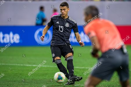 Mexico defender Hector Moreno (15) scores during the penalty kick shootout at the end of a CONCACAF Gold Cup quarterfinals soccer match between Costa Rica and Mexico at NRG Stadium in Houston, TX. Mexico won on penalty kicks 1-1 (5-4)
