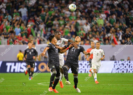 Stock Image of Mexico midfielder, Jesus Gallardo (23), and Mexico defender, Luis Rodriguez (21), work against Costa Rica forward, Joel Campbell (12), for control of the ball during the CONCACAF Gold Cup, quarter final match between Mexico and Costa Rica, at NRG Stadium in Houston, TX. Mandatory Credit: Kevin Langley/Sports South Media/CSM