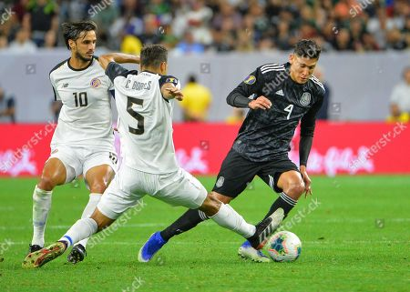 Mexico defender, Edison Alvarez (4), moves the ball downfield as Costa Rica midfielder, Celso Borges (5), tries to slide tackle, during the CONCACAF Gold Cup, quarter final match between Mexico and Costa Rica, at NRG Stadium in Houston, TX. Mandatory Credit: Kevin Langley/Sports South Media/CSM