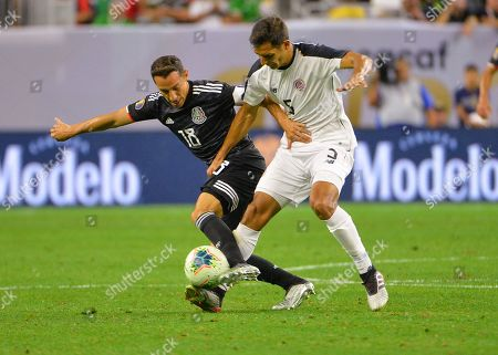 Stock Picture of Mexico midfielder, Andres Guardardo (18), and Costa Rica midfielder, Celso Borges (5), fight for ball control during the CONCACAF Gold Cup, quarter final match between Mexico and Costa Rica, at NRG Stadium in Houston, TX. Mandatory Credit: Kevin Langley/Sports South Media/CSM