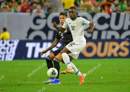 Mexico defender, Carlos Salcedo (3), and Costa Rica forward, Joel Campbell (12), fight for ball control during the CONCACAF Gold Cup, quarter final match between Mexico and Costa Rica, at NRG Stadium in Houston, TX. Mandatory Credit: Kevin Langley/Sports South Media/CSM