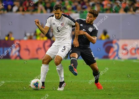 Mexico midfielder, Jonathan Dos Santos (6), and Costa Rica midfielder, Celso Borges (5), work for ball control during the CONCACAF Gold Cup, quarter final match between Mexico and Costa Rica, at NRG Stadium in Houston, TX. Mandatory Credit: Kevin Langley/Sports South Media/CSM