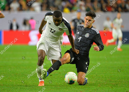 Mexico defender, Edison Alvarez (4), gets the slide tackle on Costa Rica forward, Joel Campbell (12), during the CONCACAF Gold Cup, quarter final match between Mexico and Costa Rica, at NRG Stadium in Houston, TX. Mandatory Credit: Kevin Langley/Sports South Media/CSM