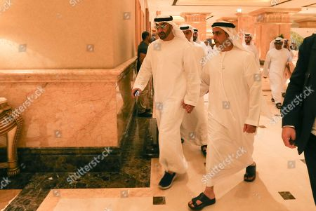 His Highness Sheikh Mohammed bin Zayed bin Sultan Al Nahyan(L), the Crown Prince of Abu Dhabi and Deputy Supreme Commander of the UAE's Armed Forces and Lieutenant General Sheikh Saif Bin Zayed al-Nahyan(C), Deputy Prime Minister walk inside Emirates Palace during the Abu Dhabi Climate Meeting, United Arab Emirates, 30 June 2019. UAE with the United Nations host the Abu Dhabi Climate Meeting as a precursor and preparation to the UN Climate Action Summit in New York USA next September.