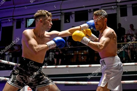 Sean Robinson (black shorts) draws with John Brennan during a Boxing Show at York Hall on 29th June 2019