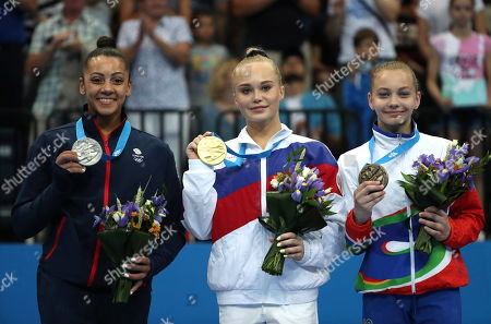 Gold medalist Angelina Melnikova of Russia (C) is flanked by silver medalist Becky Downie of Britain (L) and bronze medalist Anastasiya Alistratava of Belarus (R) during the medal ceremony of the Women's Uneven bars gymnastics final competition at the Minsk 2019 European Games in Minsk, Belarus, 30 June 2019.