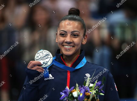 Stock Image of Silver medalist Becky Downie of Britain during the medal ceremony of the Women's Uneven bars gymnastics final competition at the Minsk 2019 European Games in Minsk, Belarus, 30 June 2019.