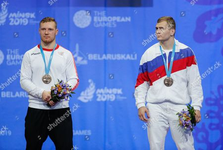 (L-R) Bronze medalists Felix Baldauf of Norway and Aleksandr Golovin of Russia pose at the medal ceremony of the Men's Greco-Roman -97kg category in the Sports Palace at the Minsk 2019 European Games in Minsk, Belarus, 30 June 2019.