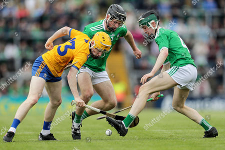 Stock Photo of Clare vs Limerick. Clare's Shane Meehan with Ronan Lyons and Fergal O'Connor of Limerick