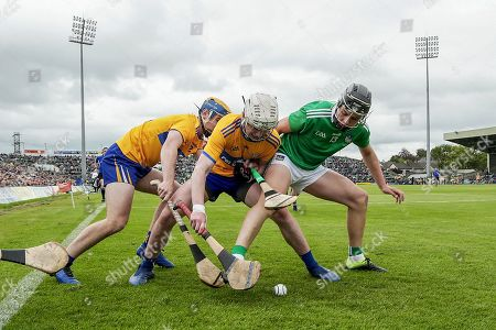 Clare vs Limerick. Clare's Adam Hogan and Storm Devanney with Aidan O'Connor of Limerick