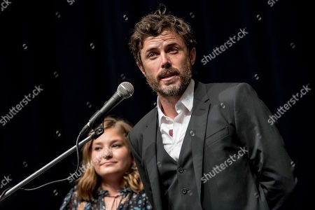 Casey Affleck speaks to audience, with Canadian actress Anna Pniowsky in the background, during the presentation of the film 'Light of My Life' at the 54th Karlovy Vary International Film Festival, in Karlovy Vary, Czech Republic, 30 June 2019. The festival runs from 28 June to 06 July.