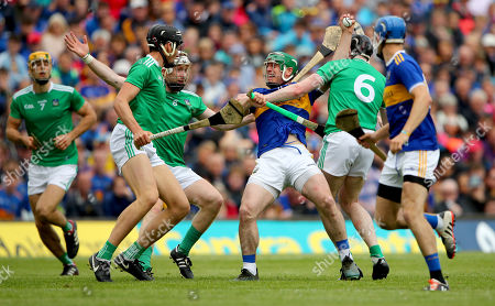 Stock Image of Tipperary vs Limerick. Limerick's Gearoid Hegarty, Cian Lynch and Declan Hannon tackle John O'Dwyer of Tipperary