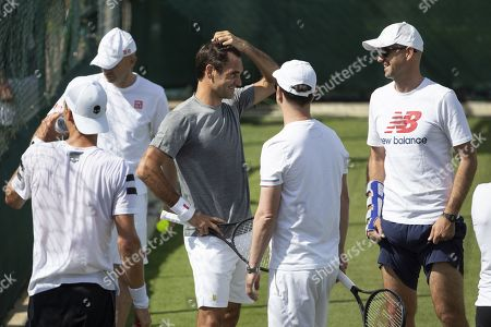 Roger Federer of Switzerland, center, with Tomas Berdych of Czech Republic, and his coaches Daniel Troxler, Severin Luethi and Ivan Ljubicic, from left, during a training session at the All England Lawn Tennis Championships in Wimbledon, London, on Sunday, June 30, 2019.