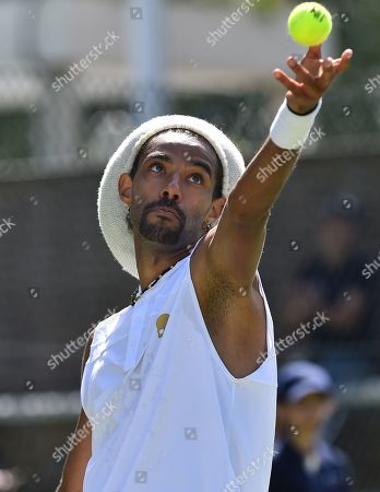 Dustin Brown of Germany, playing in The Gant Championship tennis tournament at The Roehampton Club, London.