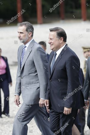 King Felipe VI of Spain (L) walks with the president of Panama Juan Carlos Varela (R) during a tour of the archaeological site of the Old Panama, with which the King inaugurated the official agenda of his visit to the Central American country, in Panama City, Panama, 30 June 2019. According to reports, King Felipe VI highlighted the transcendence of the history and common legacy of Spain and Latin America in the tribute paid to the City of Panama to mark the fifth centenary of its foundation.
