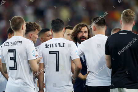 Andrea Pirlo speaks with the Germany players at the end fo the match