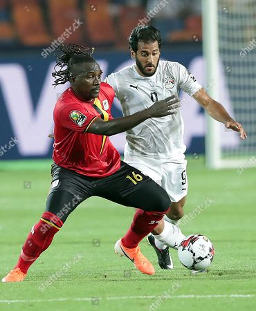Egypt's Marwan Mohsen ((R) in action against Uganda's Hassan Wasswa during the 2019 Africa Cup of Nations (AFCON) Group A soccer match between Uganda and Egypt at Cairo Stadium in Cairo, Egypt, 30 June 2019.
