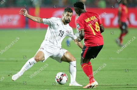 Egypt's Abdallah El Said (L) in action against Uganda's Nico Wadada during the 2019 Africa Cup of Nations (AFCON) Group A soccer match between Uganda and Egypt at Cairo Stadium in Cairo, Egypt, 30 June 2019.