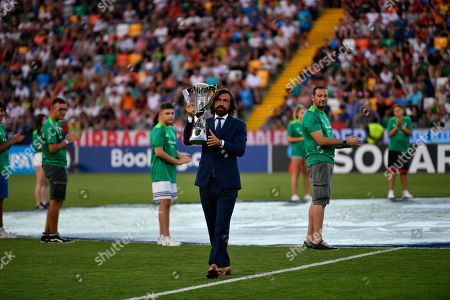 Former Italian soccer player Andrea Pirlo holds the  UEFA European Under-21 Championship 2019 trophy before the UEFA European Under-21 Championship 2019 final soccer match between Spain And Germany in Udine, Italy, 30 June 2019.