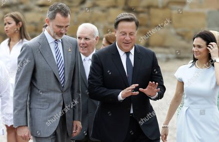 """Spain's King Felipe, left, walks with Panama's President Juan Carlos Varela as they tour the historic city center, """"Panama La Vieja,"""" in Panama City, . Spain's King is in Panama to attend the inauguration ceremony for Panama's new President Laurentino Cortizo on Monday. At right is Panamanian Foreign Minister Isabel de Saint Malo"""