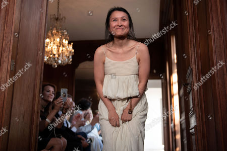 Dutch-Vietnamese designer Xuan-Thu Nguyen appears on the catwalk after the presentation of her Fall/Winter 2019/2020 Haute Couture collection for her label Xuan during the Paris Fashion Week, in Paris, France, 30 June 2019. The presentation of the Haute Couture collections runs from 30 June to 04 July 2019.