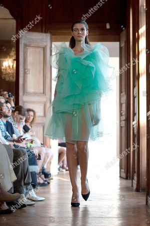 A model presents a creation from the Fall/Winter 2019/2020 Haute Couture collection by Dutch-Vietnamese designer Xuan-Thu Nguyen for her label Xuan during the Paris Fashion Week, in Paris, France, 30 June 2019. The presentation of the Haute Couture collections runs from 30 June to 04 July 2019.