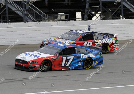 Ricky Stenhouse Jr., Kyle Busch. Ricky Stenhouse Jr (17) and Kyle Busch compete during a NASCAR Cup Series auto race at Chicagoland Speedway in Joliet, Ill