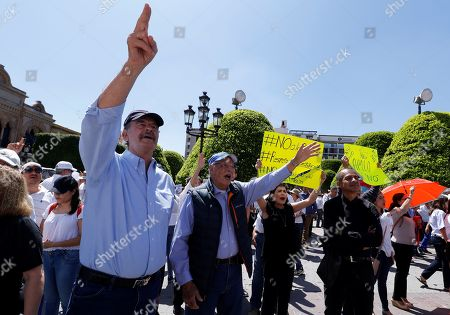 Former Mexico's President Vicente Fox (L) participate with opposition of Andres Manuel Lopez Obrador's in a march a day ahead of the first anniverrsary of Obrador's victory in the elections in Mexico City, Mexico, 30 June 2019. Obrador won the elections on 01 July 2018 with 53 percent of the counted votes and 31 out of the 32 states in Mexico. He took office on 01 December 2018.