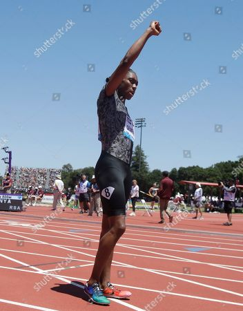 South Africa's Caster Semenya gestures while introduced before competing in the women's 800-meter race during the Prefontaine Classic, an IAAF Diamond League athletics meeting, in Stanford, Calif