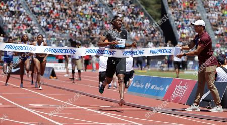 South Africa's Caster Semenya crosses the finish line to win the women's 800-meter race during the Prefontaine Classic, an IAAF Diamond League athletics meeting, in Stanford, Calif